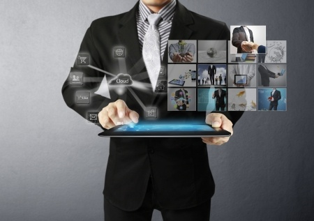 15298339 - businessman holding a tablet pc